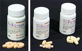 偽造品が見つかった「ハーボニー配合錠」。左が正規品(ひし形でだいだい色の錠剤)、右が偽造品(だ円形の薄紫の錠剤等)